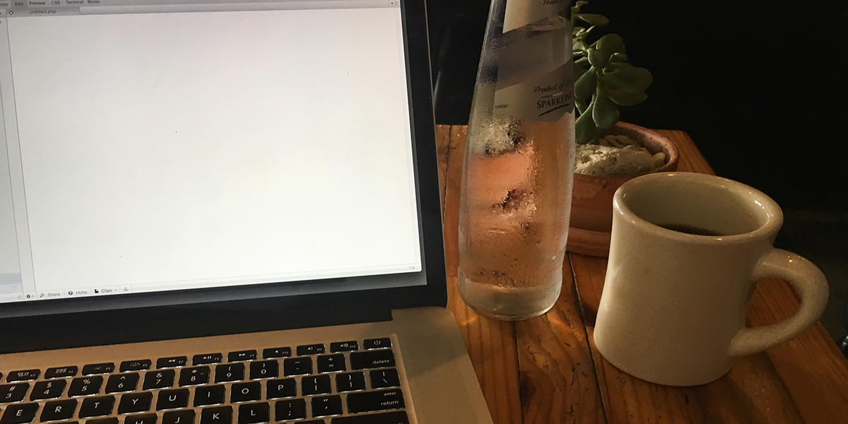Laptop, coffee, and sparkling water